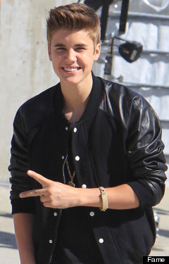 Justin Beiber, peace sign, black leather coat, haircut, smiling, braclet, sunny, vanilla ice