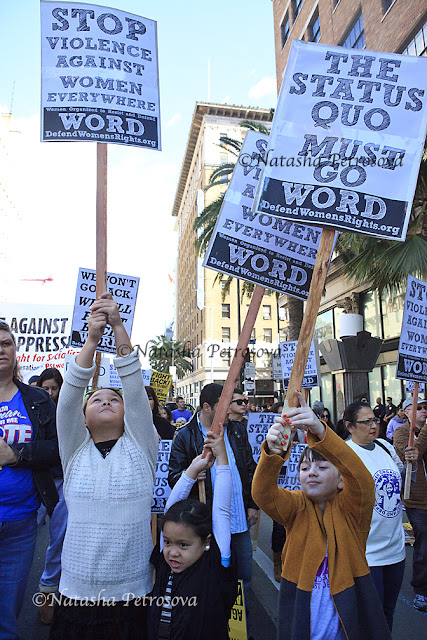 international women's day rally in hollywood, activists rally on hollywood and vine on international women's day