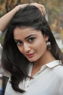 Tridha Chowdary Stills At Surya vs Surya Movie Success Meet 17.jpg