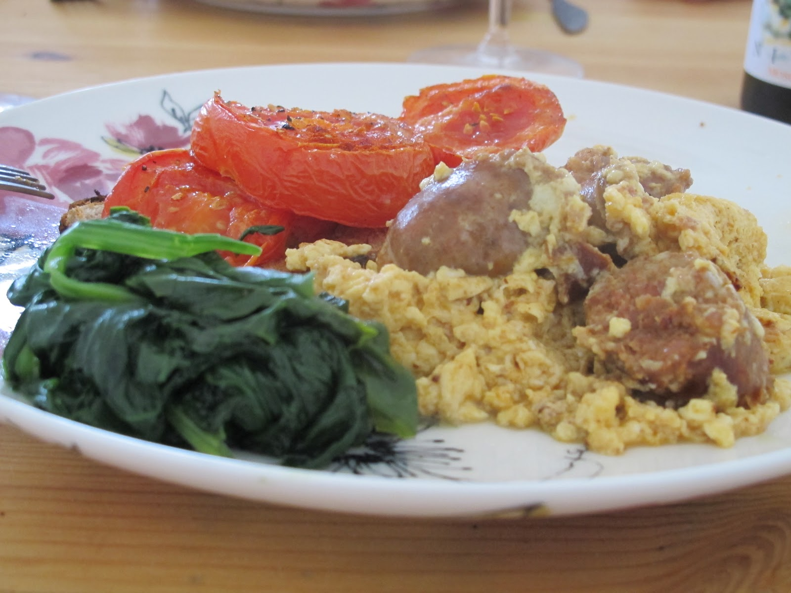 Chorizo scrambled eggs with roasted beeftomatoes and buttery spinach