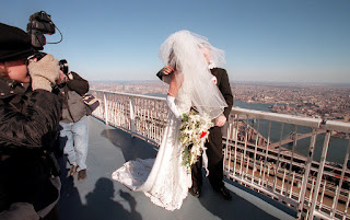 A wedding takes place at the top of the World Trade Center
