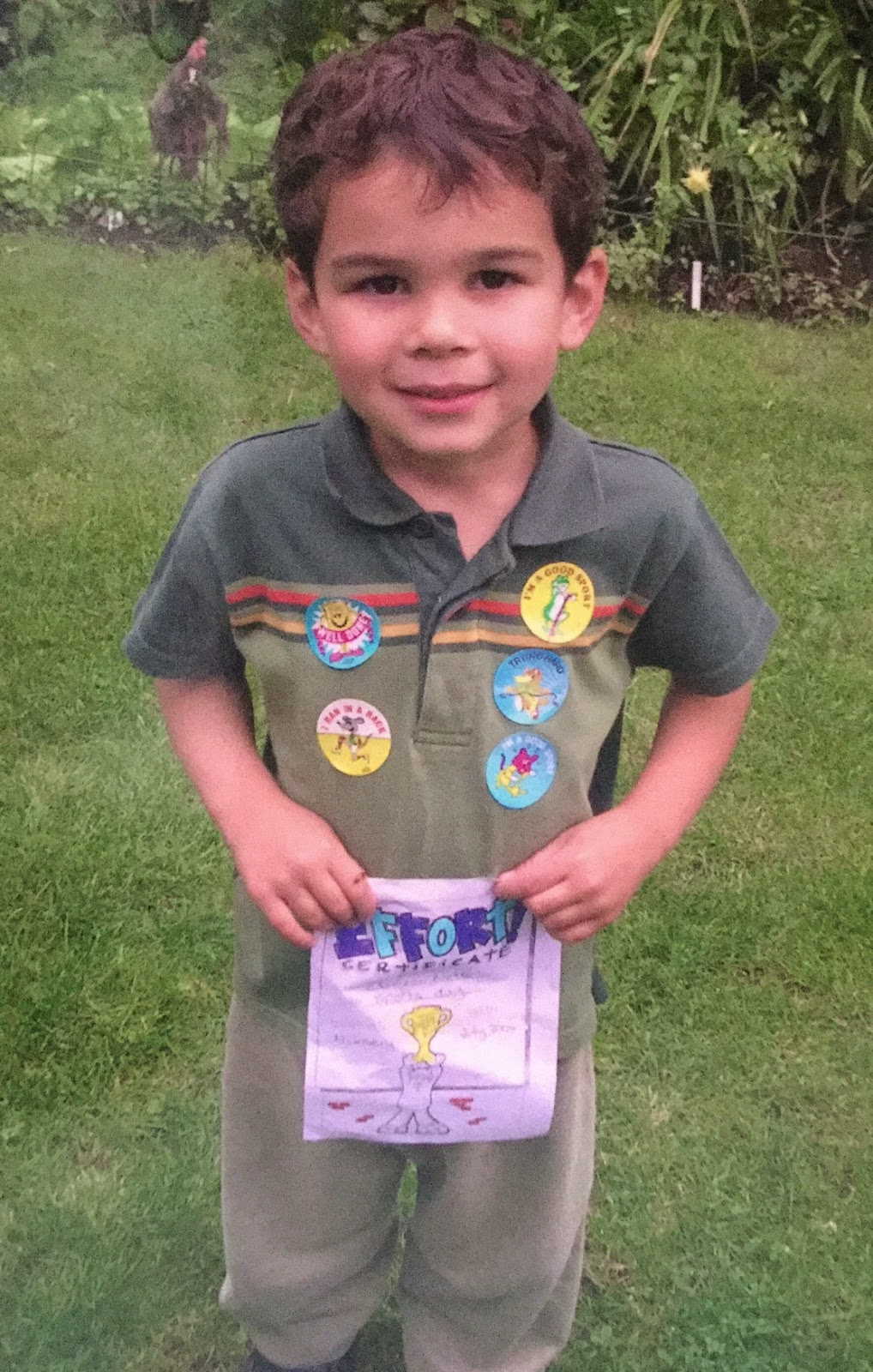 Pic of son on nursery school sports' day with winning stickers and effort certificate