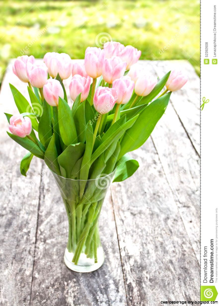 Bouquet Of Light Pink Tulips On The Oak Brown Table In A Clear G