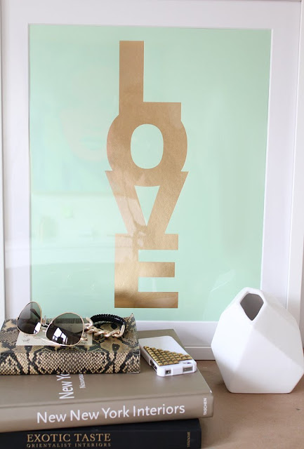 Letter press print on mint green paper with LOVE written in gold