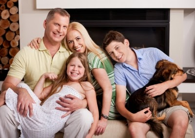 Family & pet smiling in clean air