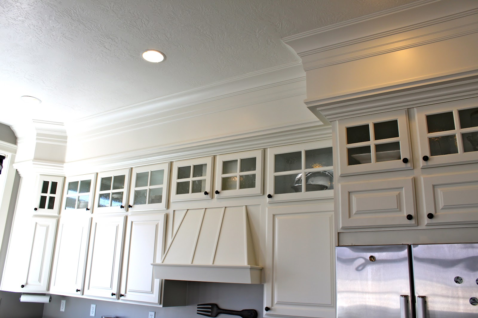 Amy 39 s casablanca kitchen soffit transformation for Adding crown molding to kitchen cabinets before after