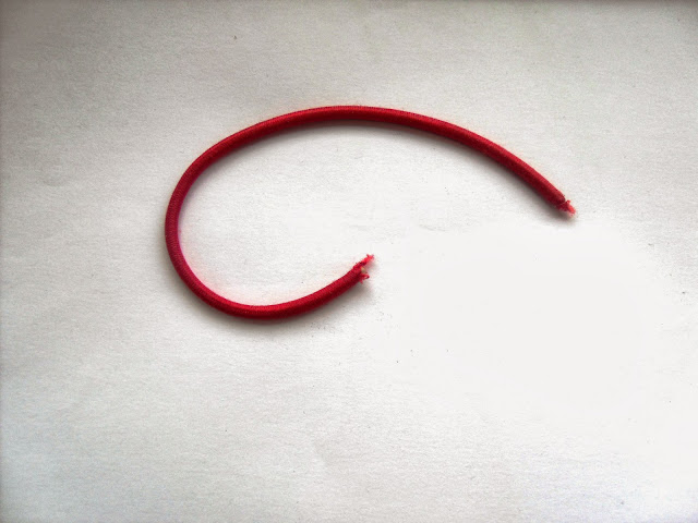 Overstretched, snapped hair tie