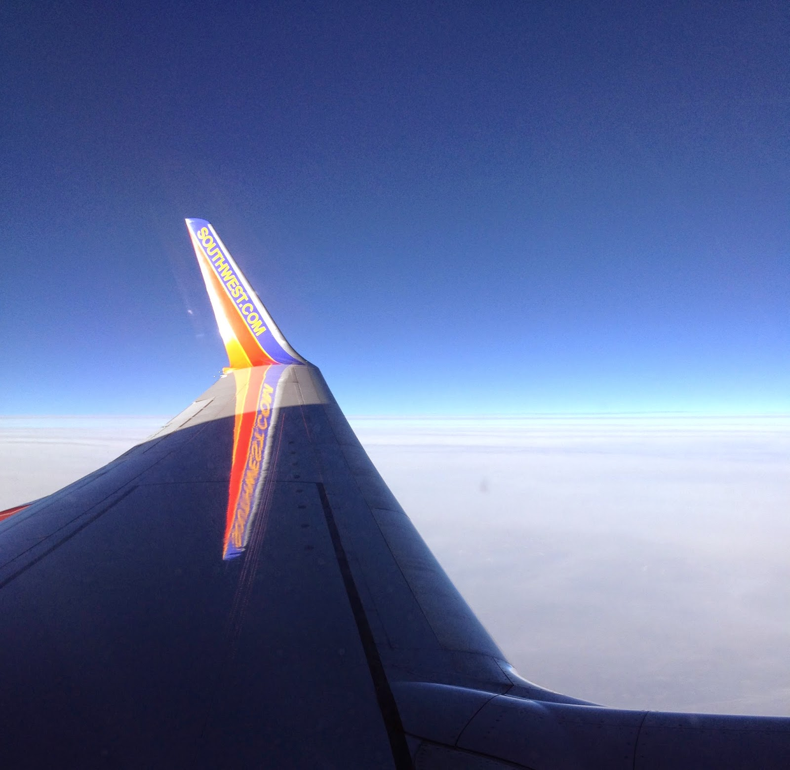 plane wing above the clouds
