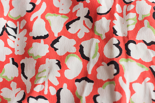 floral pattern on coral dress