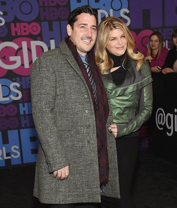 Kicking it with fashion's finest must come naturally to Kirstie Alley's garment collection.  To her outfit for the Girls season 4 premiere at New York, NY, USA on Monday, January 5, 2015, the 63-year-old rocked a lovely forest green jacket over a dark coat and a tight matching of pencil skirt, then slipped her feet into a pair of high-heeled shoes.