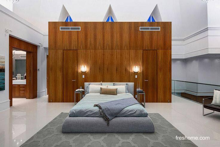 Dormitorio contemporáneo en penthouse de torre residencial en Canadá