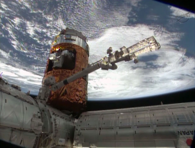 The H-II Transfer Vehicle-4 with its Exposed Pallet installed inside the unpressurized section is featured in this image from the International Space Station. Image Credit: NASA TV