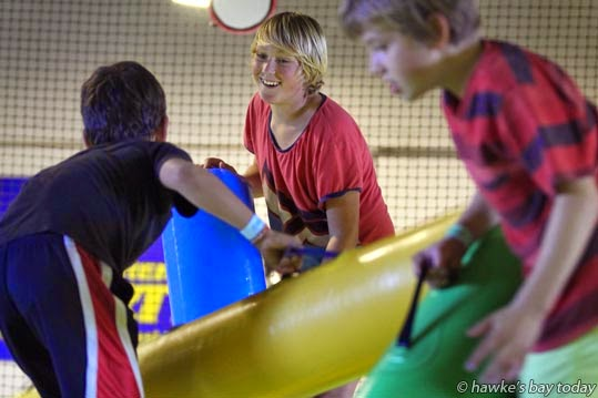 Centre: Nick Biles, 11, Napier, having fun jousting at Inflatable World, Thames St, Pandora, Napier photograph