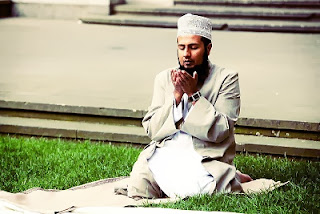 A young Muslim man praying