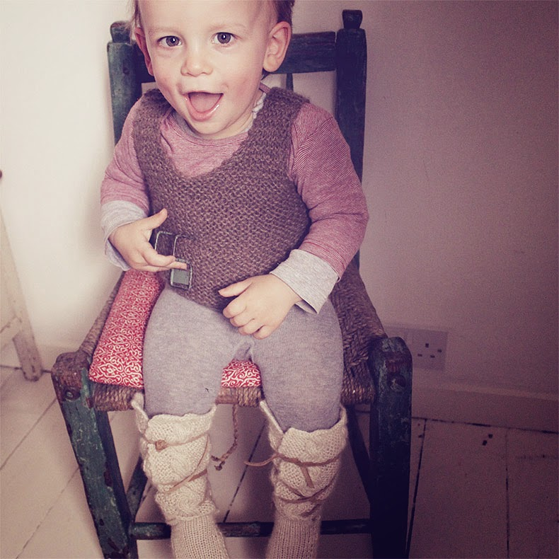 Knitted baby waistcoat and boots by Hambro & Miller for autumn 2014
