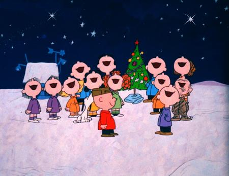 The children singing in front of Snoopy's doghouse in A Charlie Brown Christmas 1965 animatedfilmreviews.blogspot.com