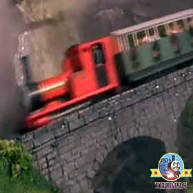 Fast roller coaster ride Rheneas the tank engine splashed under a waterfall happy children laughing