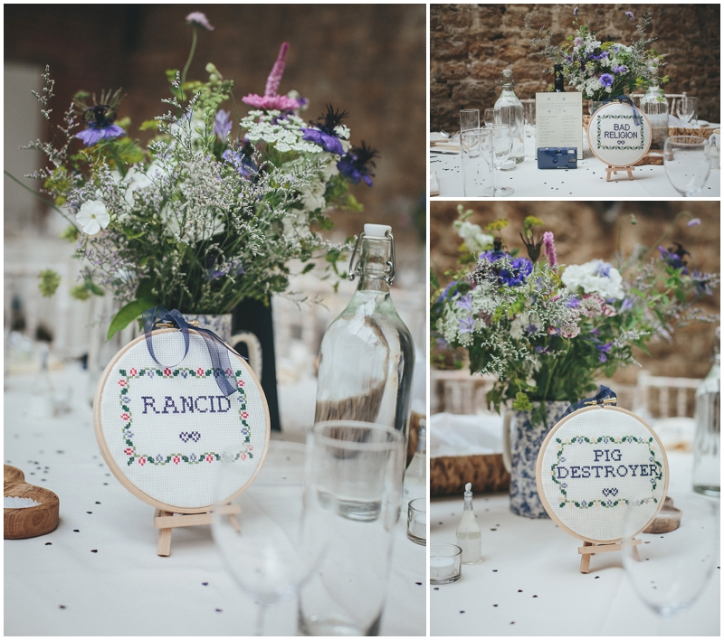 Cross stitched table names at the Tithe Barn