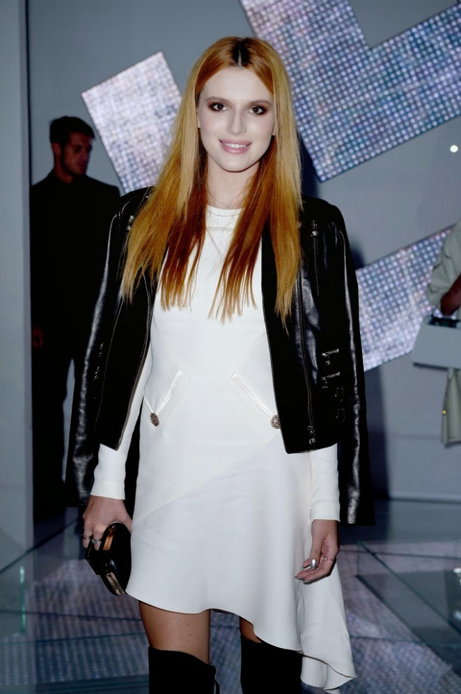 Bella Thorne wears leather jacket and stiletto boots to the Versace Spring/Summer 2015 Milan Fashion Week Show