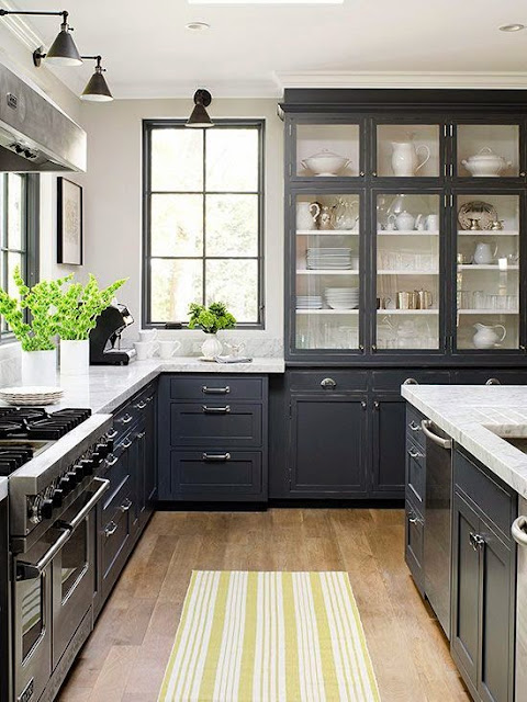 open spaces with dark kitchen cabinets