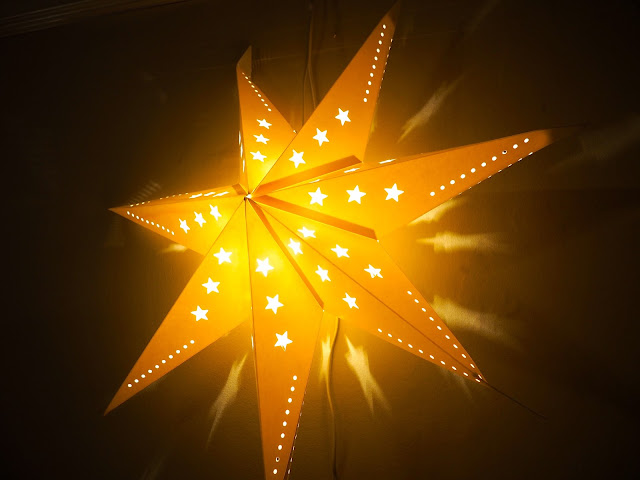 Big light up star decorating the living room for Christmas