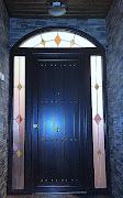 Esta puerta de entrada pertenece a la serien rústica de nuestra fabricación .