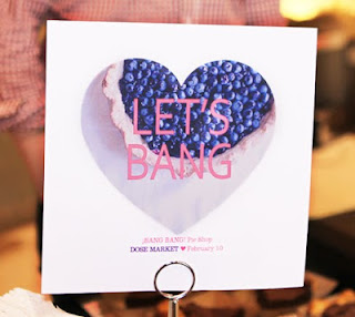 "Let's Bang! sign from ¡BANG BANG! Pie Shop at the dose ""Love"" market."
