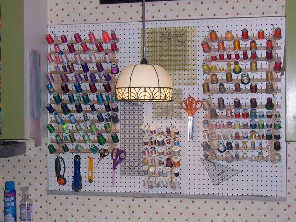 little house turns a closet into her sewing space and uses pegboard