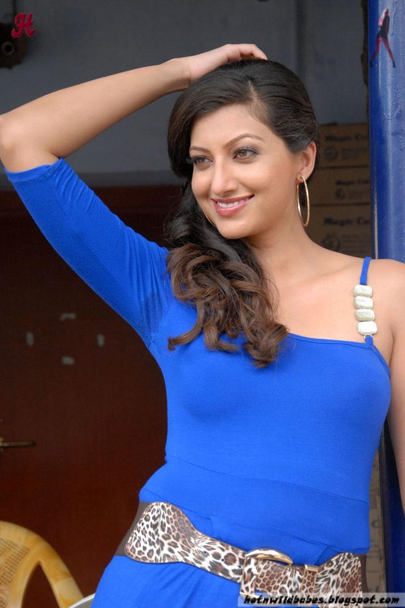 Hamsa Nandini flaunting her fleshy curves in a blue skin tight cloths