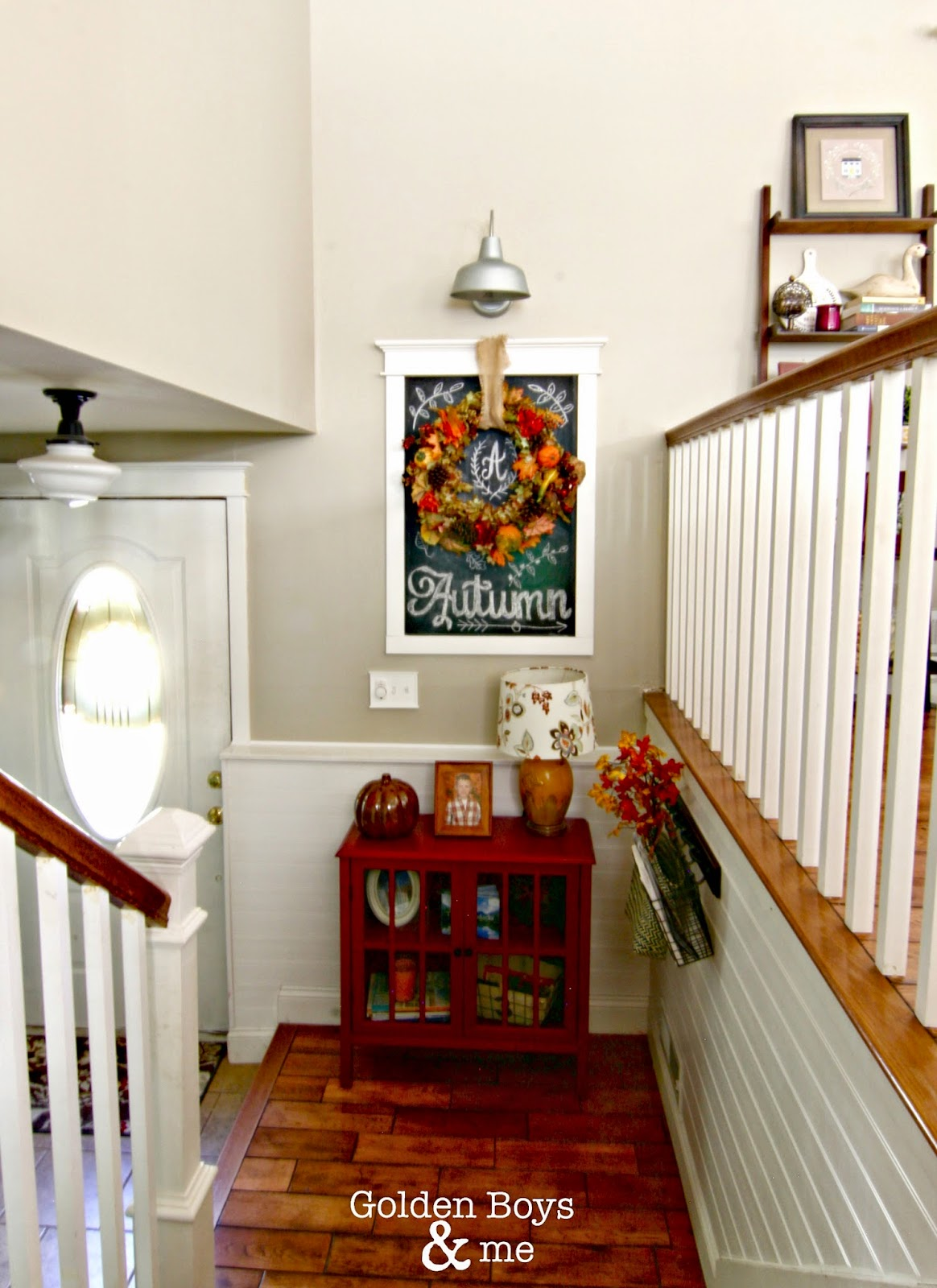 Fall decor in split level entryway/foyer with wreath and Autumn chalk art-www.goldenboysandme.com
