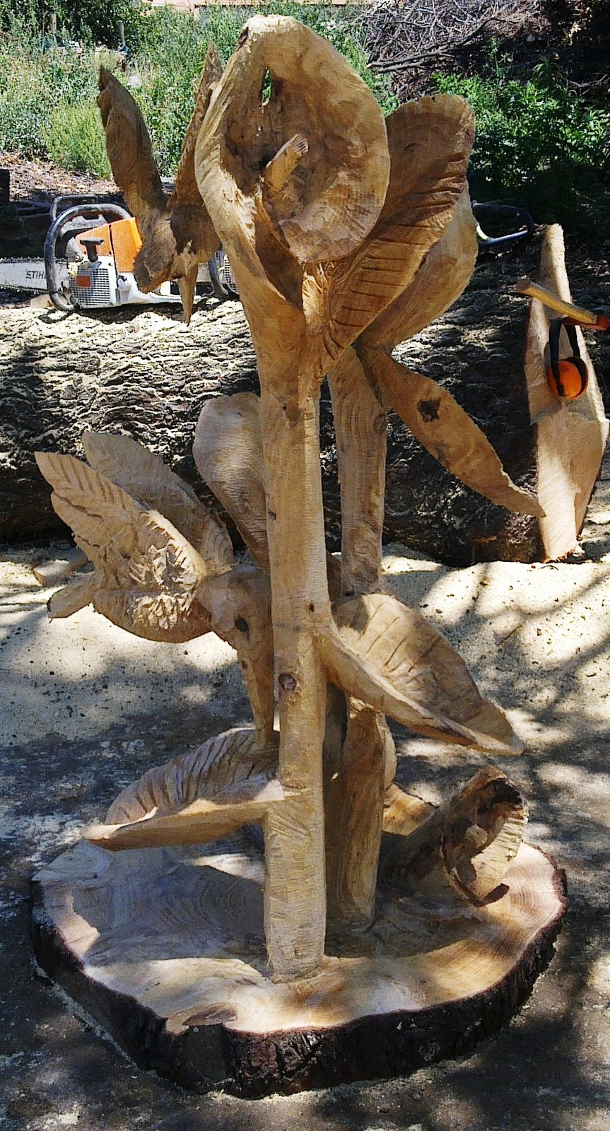 South african chainsaw carving arts flowers and birds