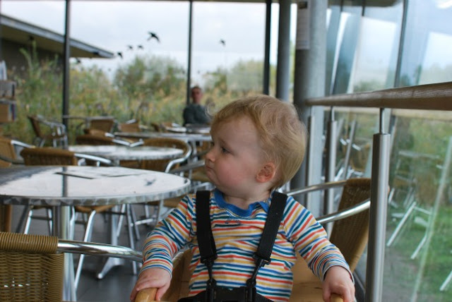 Baby sat in highchair waiting for food