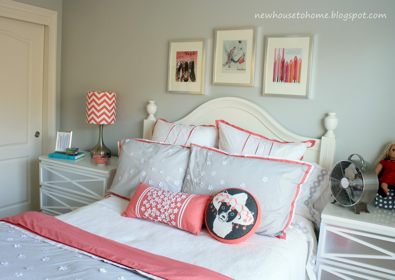 the pretty coral and gray bedding that Abigail selected for her room  title=