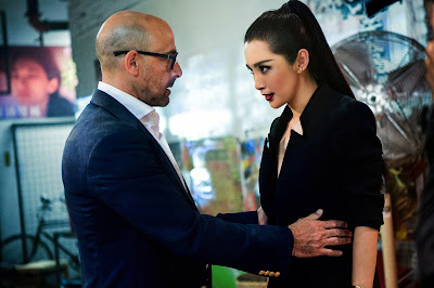 Li Bingbing and Stanley Tucci in Transformers Age of Extinction