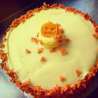 lemon butter cream cake with scary Halloween pumpkin for decoration