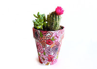 http://styleandspice.com/hand-painted-planter/
