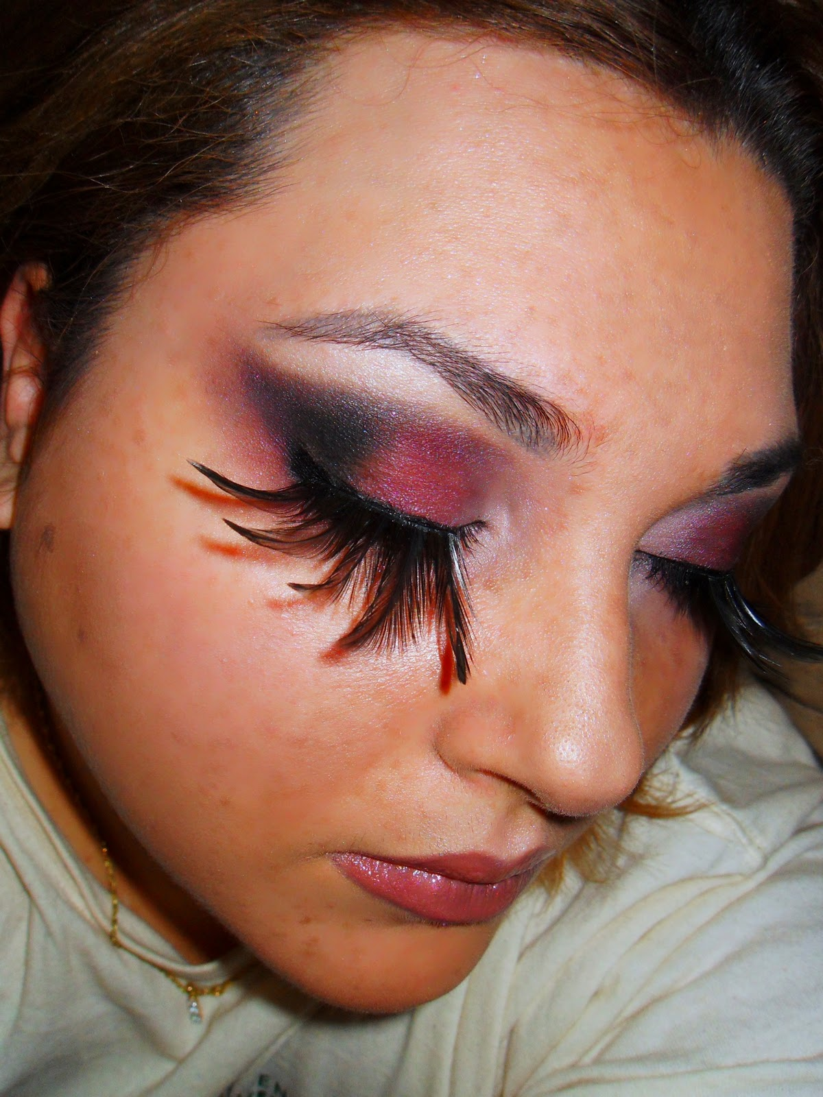 """The feathers (or wings) are black, and the eye makeup is generally dark since I have """"fallen"""" from above. However, I am still an angel, so I had to glow :)"""