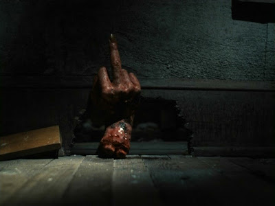 Ash's possessed hand sticking up the middle finger in Evil Dead II