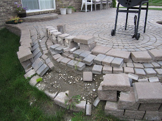 The Homeowner Noticed About A Year After This Pavers Patio Was Installed By  An Inexperienced Landscaper That The Wall Blocks U0026 Caps Were Leaning Out.