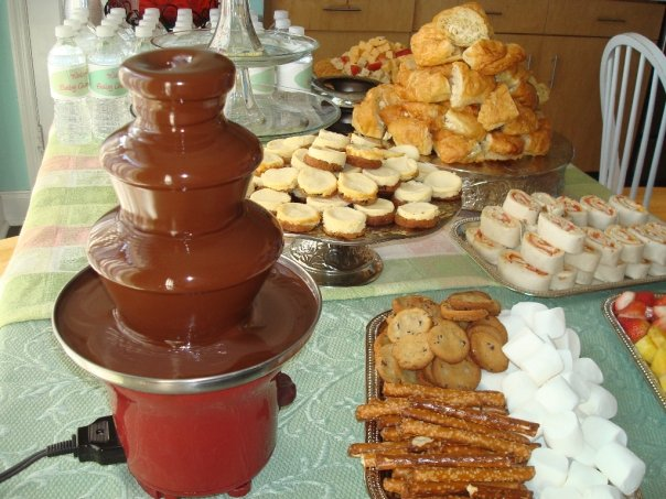 The above is a mini chocolate fountain at a baby shower between the chocolate fountain dippables and the mini cheesecakes on the table everyones sweet ... : chocolate fountain table set up - pezcame.com