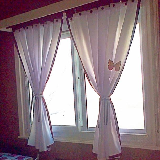 cortina de tela tropical con botones y detalles