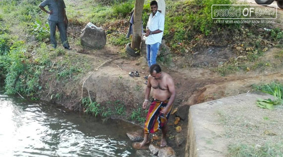 Mahindananda Aluthgamage swims in the Minipe Canal