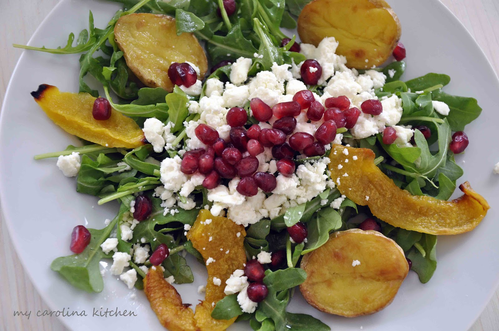 Winter Salad with Roasted Squash, Potatoes, & Pomegranate Seeds over ...