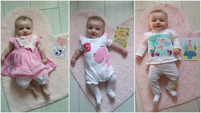baby lying on pink rug with milestone cards at 8 weeks, 10 weeks and 12 weeks old