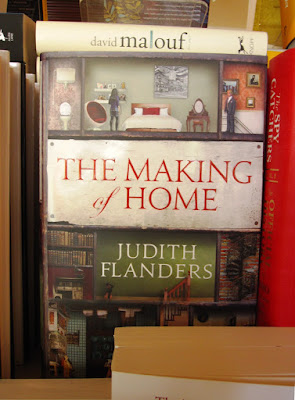 A copy of the book 'The Making of Home' on display in a book shop.