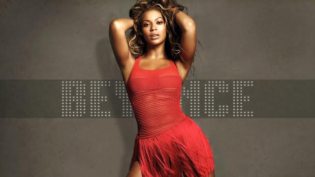Beyonce con un vestido color rojo