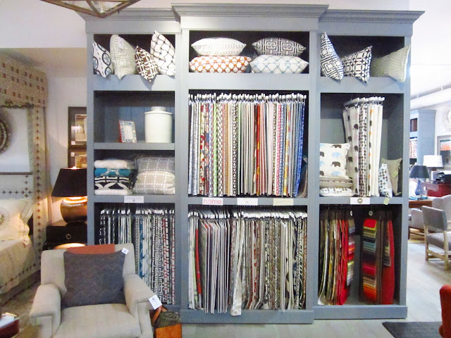 Textiles display with COCOCOZY fabrics, pillows and throws