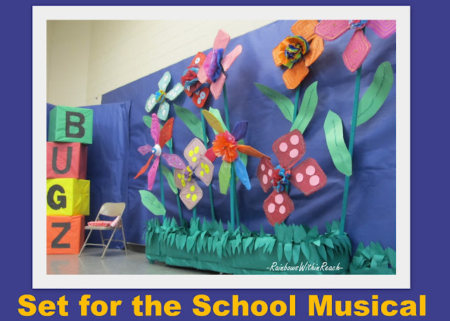 photo of: set design for elementary school musical, over-sized flower backdrop