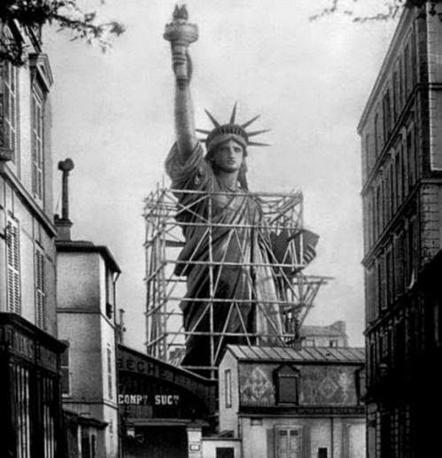 The Statue of Liberty surrounded by scaffolding as workers complete the final stages in Paris (1885).