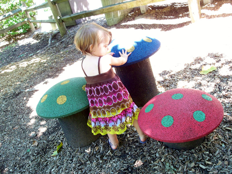 Addie playing on the mushrooms at the playground at the PPG zoo and aquarium in Pittsburgh